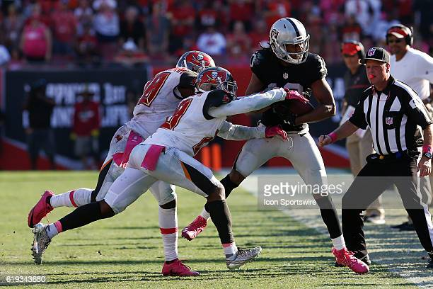 Oakland Raiders wide receiver Seth Roberts is forced out of bounds by Tampa Bay Buccaneers cornerback Vernon Hargreaves and Tampa Bay Buccaneers...