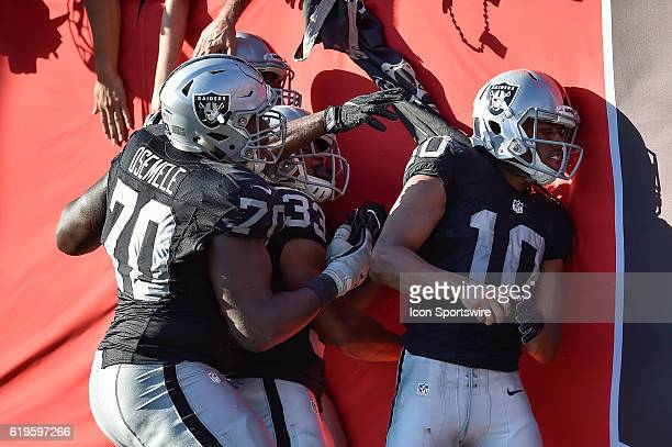 Oakland Raiders Wide Receiver Seth Roberts is quickly joined by his teammates as they celebrate his gamewinning overtime touchdown during an NFL...