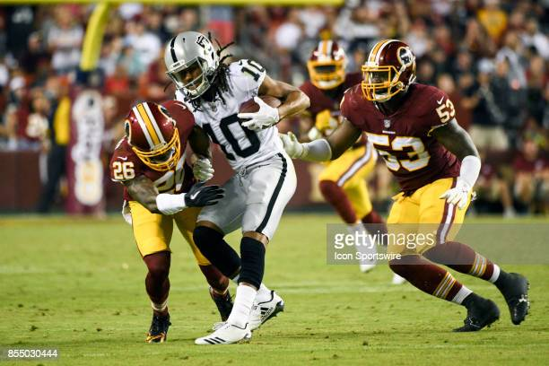Oakland Raiders wide receiver Seth Roberts is tackled by Washington Redskins cornerback Bashaud Breeland and inside linebacker Zach Brown on...