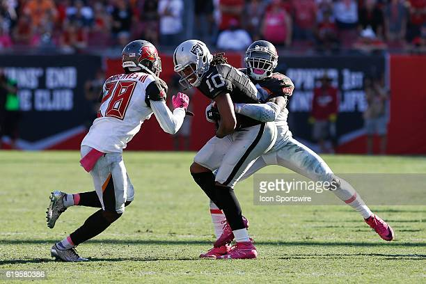 Oakland Raiders wide receiver Seth Roberts is wrapped up by Tampa Bay Buccaneers middle linebacker Kwon Alexander with help from Tampa Bay Buccaneers...