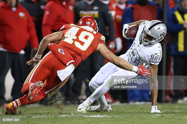 Oakland Raiders wide receiver Seth Roberts tries to evade the tackle of Kansas City Chiefs defensive back Daniel Sorensen after a catch in the fourth...