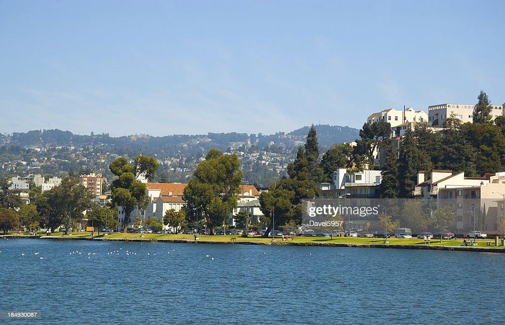 'Oakland's Lake Merritt, park, and apartment buildings'