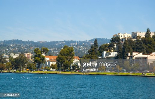 Oakland's Lake Merritt, park, and apartment buildings