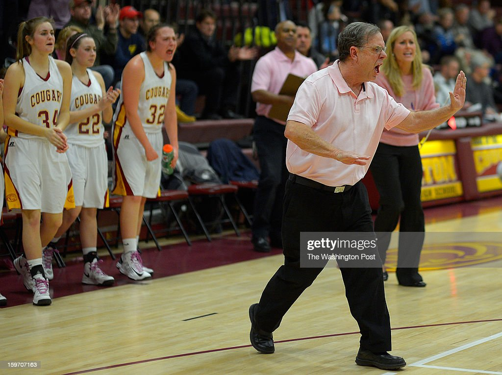 Oakton head coach Fred Priester greets his team coming off the floor at half time as Oakton defeats Centerville in girls basketball at Oakton High School in Oakton VA, January 18, 2012 .