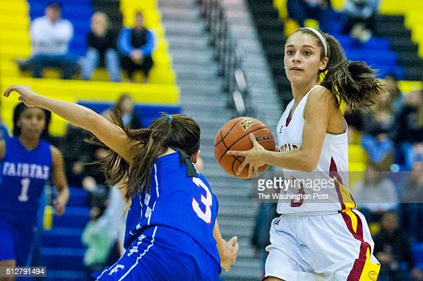 Oakton's Alex Marquis looks for an open teammate against Fairfax during first quarter action in the Virginia 6A Northern Regional girl's basketball...