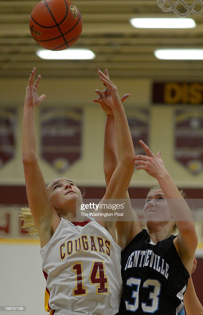 Oakton's Karlie Cronin, left, grabs a rebound against Centerville's Tori Collar as Oakton defeats Centerville in girls basketball at Oakton High School in Oakton VA, January 18, 2012 .