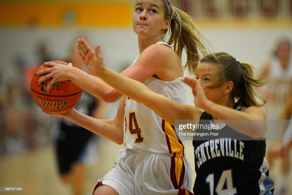 Oakton's Karlie Cronin, left, is fouled by Centerville's Katie Blumer as Oakton defeats Centerville in girls basketball at Oakton High School in Oakton VA, January 18, 2012 .