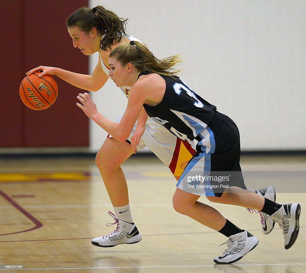 Oakton's Lindsey Abed, left, brings the ball up court against Centerville's Caroline Wakefield as Oakton defeats Centerville in girls basketball at Oakton High School in Oakton VA, January 18, 2012 .
