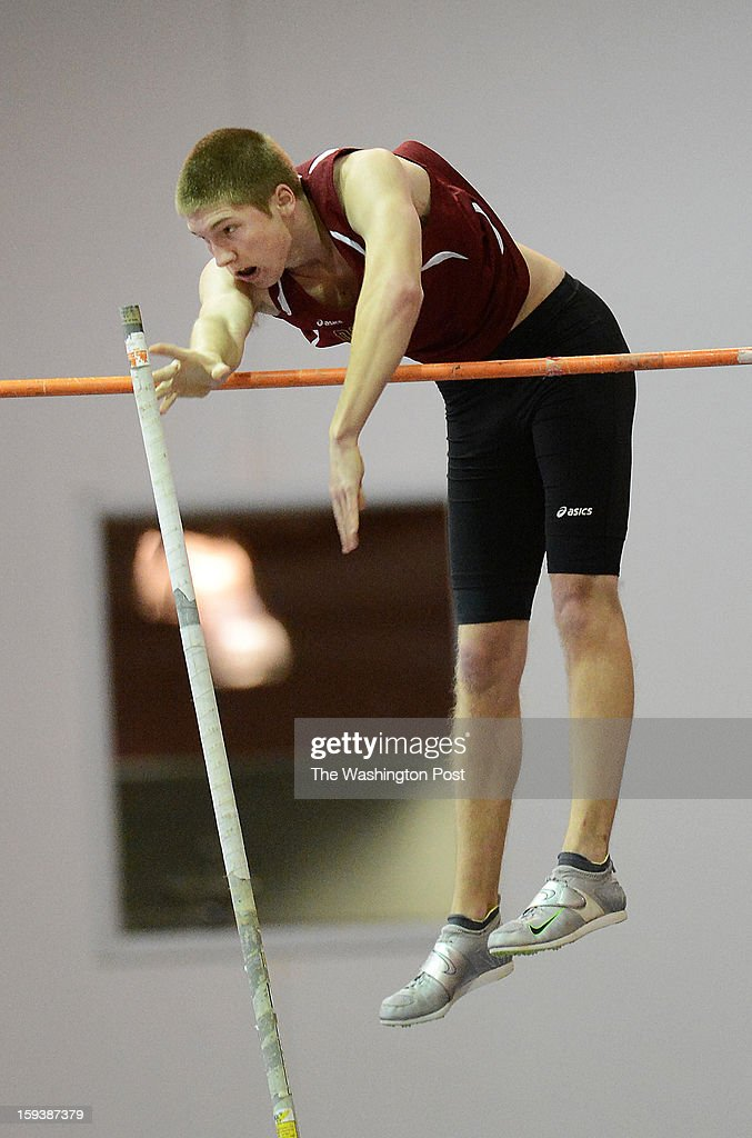 Oakton's Lucas Wratschko clear the bar after pole vaulting to a winning height of 14-06.00 during the Montgomery Invitational Track and Field Championships at the Prince George's Sports & Learning Complex on Saturday, January 12, 2013.