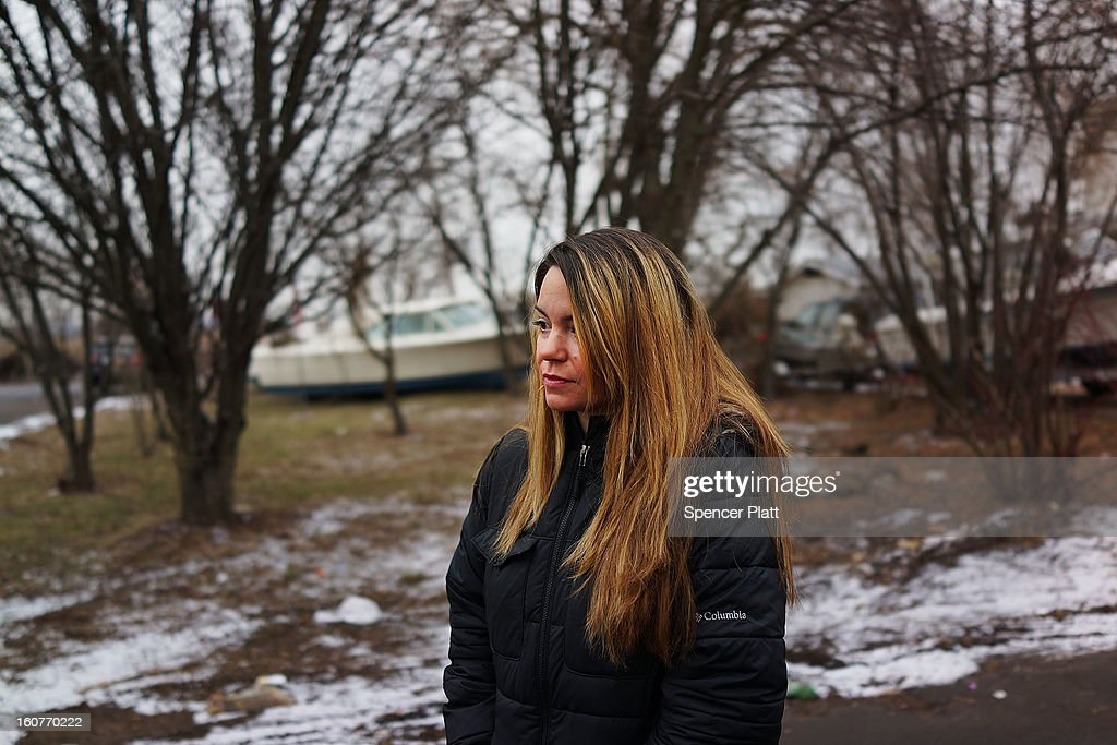 Oakwood Beach resident Samantha Langello, who lost her home, stands in the the heavily flood damaged Staten Island neighborhood on February 5, 2013 in New York City. In a program proposed by New York Governor Andrew Cuomo, New York state could spend up to $400 million to buy out home owners whose properties were destroyed by Superstorm Sandy. The $50.5 billion disaster relief package, which was passed by Congress last month, would be used to fund the program. If the program is adopted, homeowners would be relocated and their land would be left as a natural barrier to help absorb future floods waters.