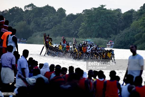 Oarsmen row a serpentine boat in unison as they compete in the Mahatma Boat Race at Pamba River ahead of Onam celebrations at Chengannur near the...