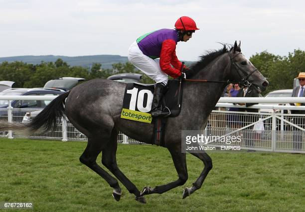 Oasis Dancer ridden by jockey Jim Crowley going to post prior to the totesport Mile during day four of the Glorious Goodwood Festival at Goodwood...