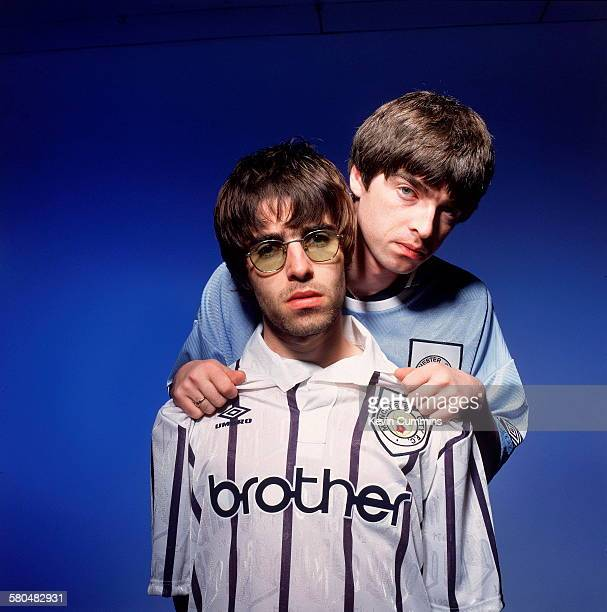 Oasis singer Liam Gallagher and his brother guitarist Noel Gallagher of British rock group Oasis Portsmouth 9th May 1994 Both are sporting Manchester...