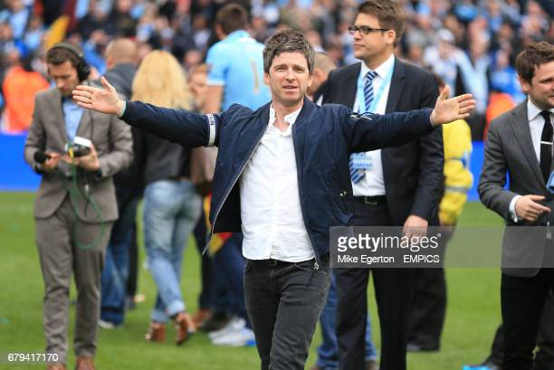 Oasis singer Noel Gallagher celebrates Manchester City's victory