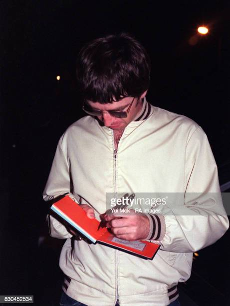 Oasis singersongwriter Noel Gallagher sings autographs as he leaves Air Studios in Hampstead London after attending a John Lennon tribute recording...