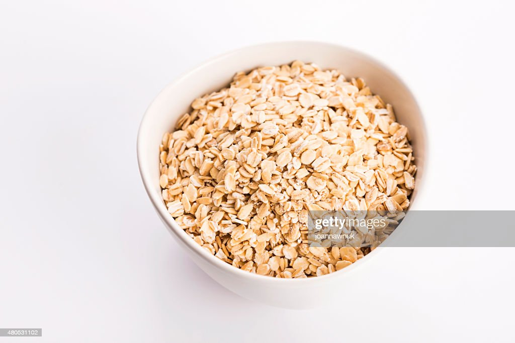 Oat flakes in bowl : Stock Photo