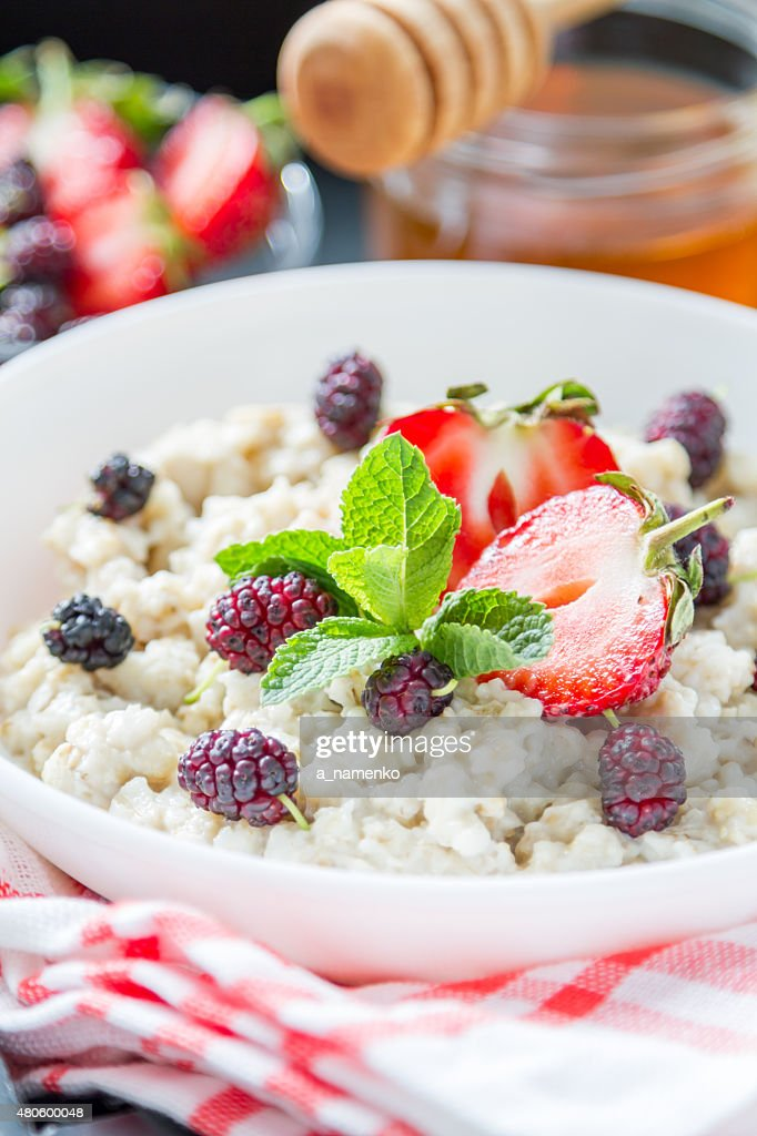 Oat meal with strawberry, blackberry, mint, honey, milk, juice : Stock Photo