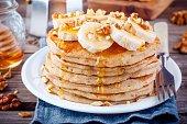 Breakfast oatmeal pancakes with banana, walnuts and honey