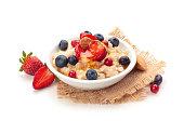 Oatmeal and fresh fruits isolated on white background.