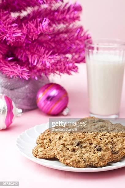 Oatmeal cookies under pink Christmas tree.