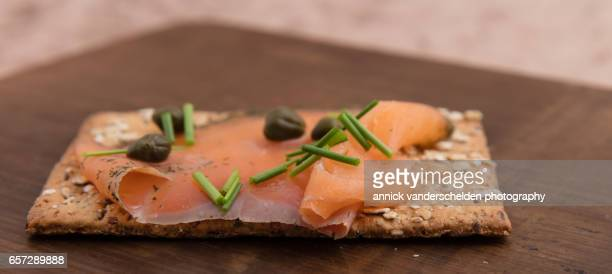 Oatmeal cracker with salmon.