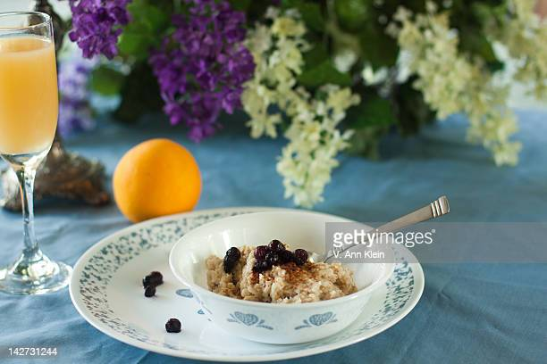 Oatmeal with bueberries, orange juice and orange