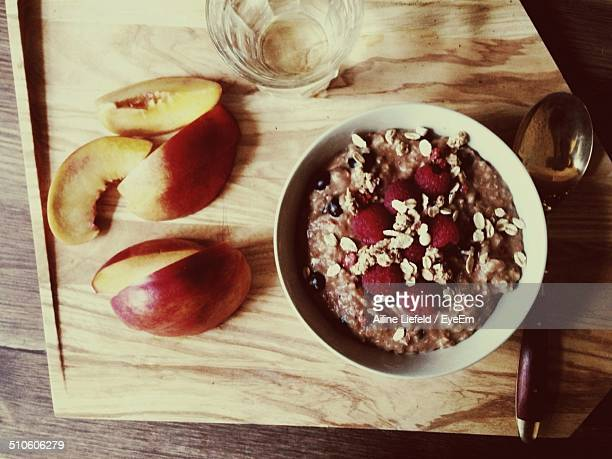 Oatmeal with sliced apple served on table