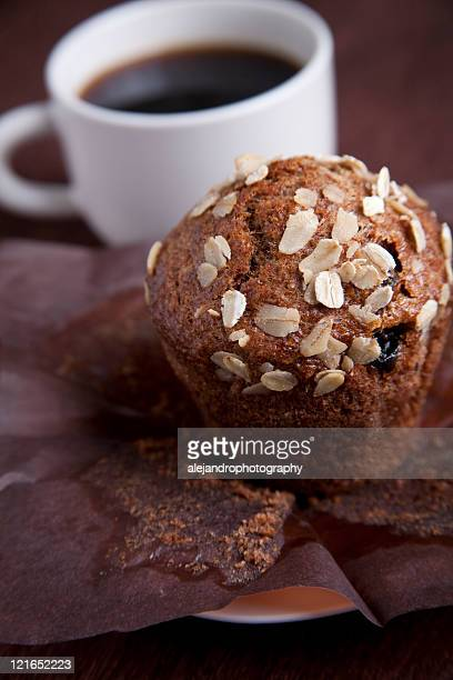 oats and raisin muffin with a black cup of coffee