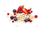 Oats, honey and fresh fruits isolated on white background.