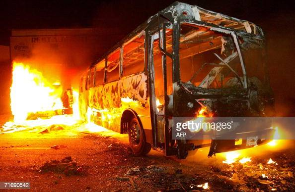 A bus burns as consecuence of a riot between teachers on strike and some unknown agressors in Oaxaca Mexico 21 August 2006 School year starts Monday...