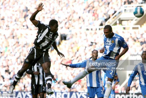Obafemi Martins Newcastle United and Marcus Bent Wigan Athletic battle for the ball