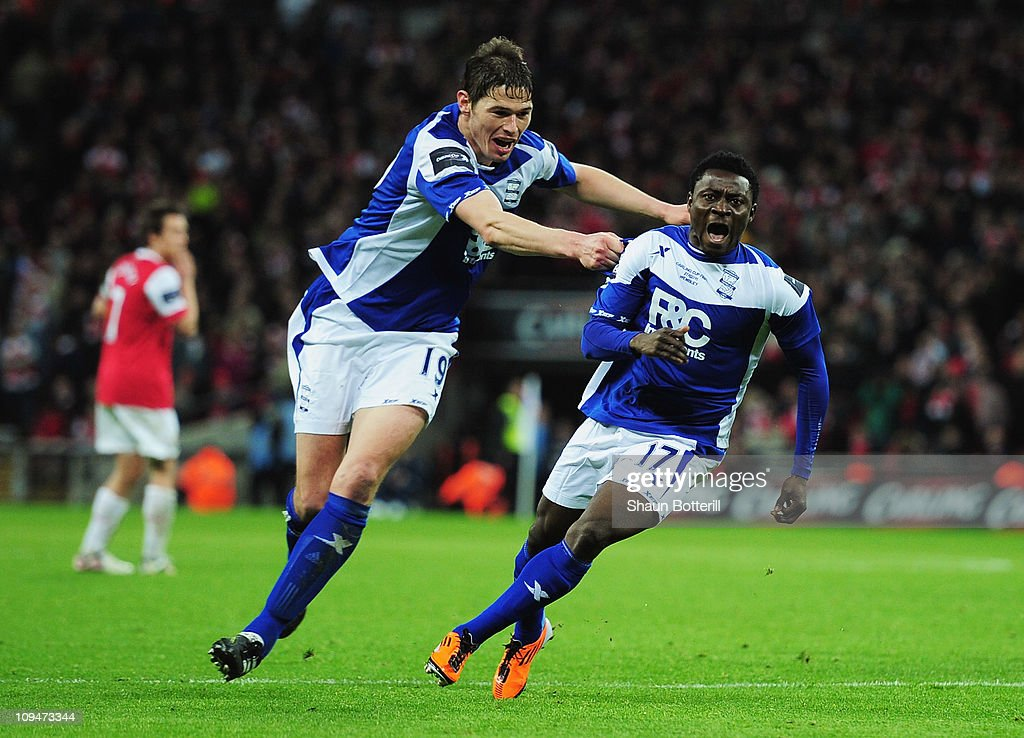 <a gi-track='captionPersonalityLinkClicked' href=/galleries/search?phrase=Obafemi+Martins&family=editorial&specificpeople=224574 ng-click='$event.stopPropagation()'>Obafemi Martins</a> (R) of Birmingham City celebrates the winning goal with <a gi-track='captionPersonalityLinkClicked' href=/galleries/search?phrase=Nikola+Zigic&family=editorial&specificpeople=550649 ng-click='$event.stopPropagation()'>Nikola Zigic</a> during the Carling Cup Final between Arsenal and Birmingham City at Wembley Stadium on February 27, 2011 in London, England.