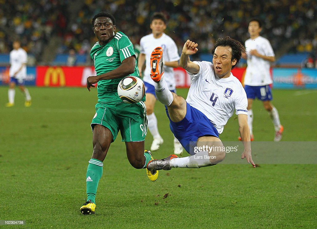 <a gi-track='captionPersonalityLinkClicked' href=/galleries/search?phrase=Obafemi+Martins&family=editorial&specificpeople=224574 ng-click='$event.stopPropagation()'>Obafemi Martins</a> of Nigeria is tackled by <a gi-track='captionPersonalityLinkClicked' href=/galleries/search?phrase=Cho+Yong-Hyung&family=editorial&specificpeople=2150888 ng-click='$event.stopPropagation()'>Cho Yong-Hyung</a> of South Korea during the 2010 FIFA World Cup South Africa Group B match between Nigeria and South Korea at Durban Stadium on June 22, 2010 in Durban, South Africa.