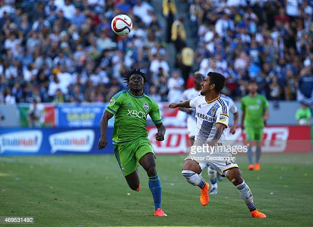 Obafemi Martins of Seattle Sounders FC and AJ DeLaGarza of Los Angeles Galaxy vie for the ball in the second half of the MLS match at StubHub Center...