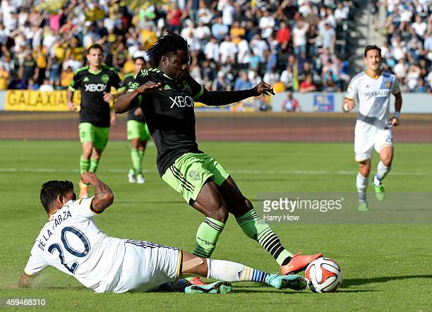 Obafemi Martins of Seattle Sounders FC has his pass blocked by AJ DeLaGarza of Los Angeles Galaxy during the Western Conference Final at StubHub...