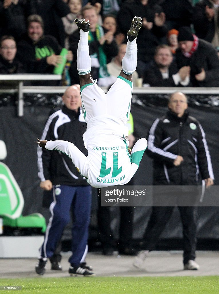 <a gi-track='captionPersonalityLinkClicked' href=/galleries/search?phrase=Obafemi+Martins&family=editorial&specificpeople=224574 ng-click='$event.stopPropagation()'>Obafemi Martins</a> of Wolfsburg celebrates after scoring his team's first goal during the UEFA Europa League round of 16 second leg match between VfL Wolfsburg and Rubin Kazan at Volkswagen Arena on March 18, 2010 in Wolfsburg, Germany.