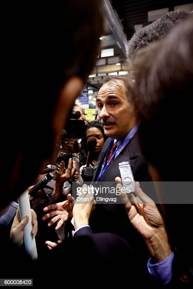 Obama campaign manager David Axelrod speaks with the media in the spin room after the final Presidential Debate held at the Hofstra University in...