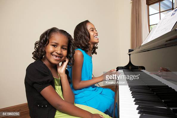 President Barack Obama's daughters Malia Obama and Sasha Obama are photographed for Essence Magazine on June 19 2008 in Washington DC
