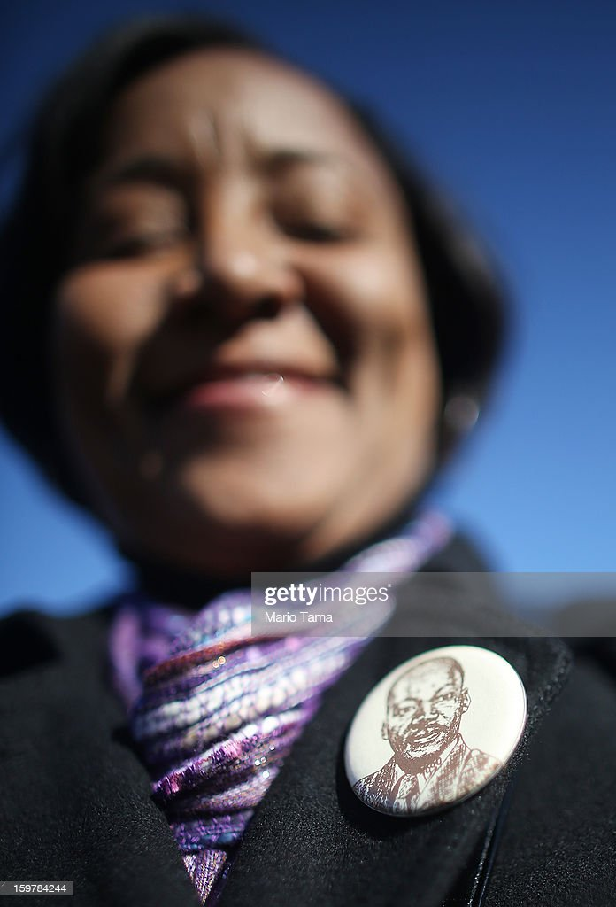 Obama supporter Beverly Rideaux wears a Dr. Martin Luther King Jr. button during preparations for U.S. President Barack Obama's second inauguration on January 20, 2013 in Washington, DC. The U.S. capital is preparing for the second inauguration of U.S. President Barack Obama, which will take place on January 21.