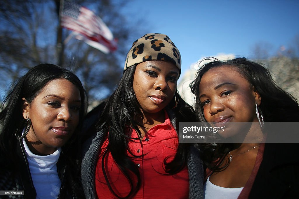 Obama supporters (L to R) Erin Mackey, Yvette Adams and Lakeisha Vaden pose as Washington prepares for President Barack Obama's second inauguration on January 20, 2013 in Washington, DC. The U.S. capital is preparing for the second inauguration of U.S. President Barack Obama, which will take place on January 21.