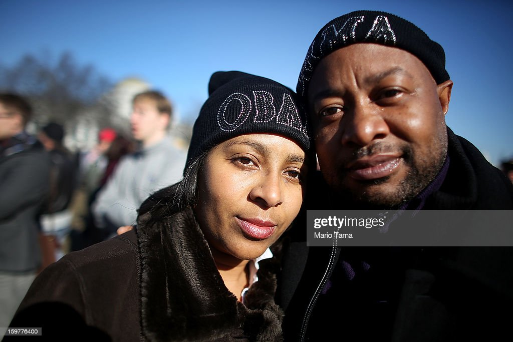 Obama supporters Teresa Thomason and Charles Walker pose with their Obama hats as Washington prepares for President Barack Obama's second inauguration on January 20, 2013 in Washington, DC. One day before the public inaugural ceremony at the U.S. Capitol on January 21, Obama was officially sworn in for his second term during a private ceremony surrounded by friends and family in the Blue Room of the White House.