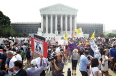 Obamacare supporters and protesters gather in front of the US Supreme Court to find out the ruling on the Affordable Health Act June 28 2012 in front...