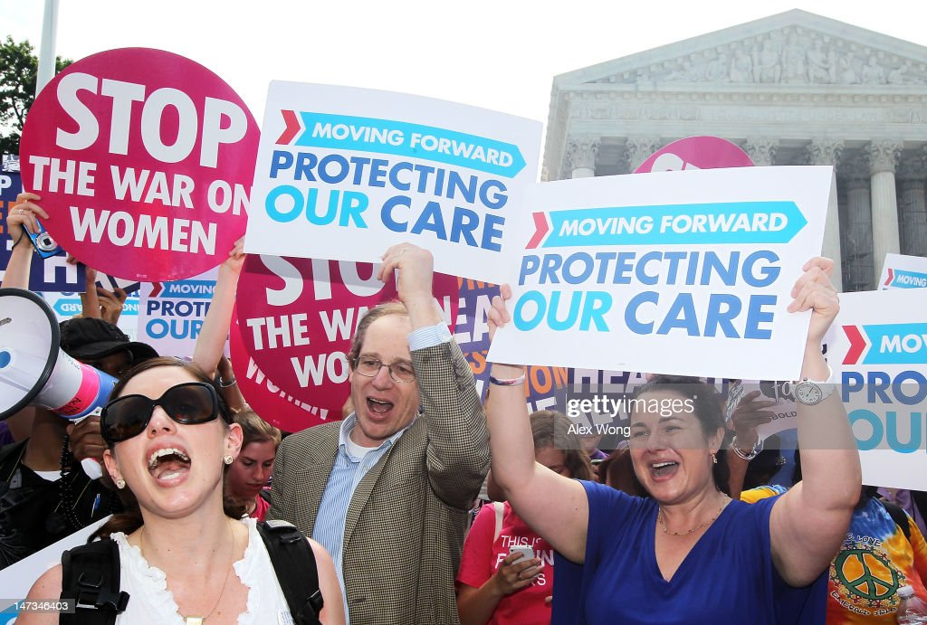 Obamacare supporters celebrate as they respond to the Supreme Court ruling on the Affordable Health Act June 28, 2012 in front of the U.S. Supreme Court in Washington, DC. The Supreme Court has upheld the whole healthcare law of the Obama Administration.