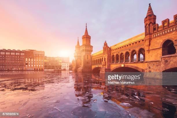 Oberbaumbruecke Winter Berlin with frozen Spree River
