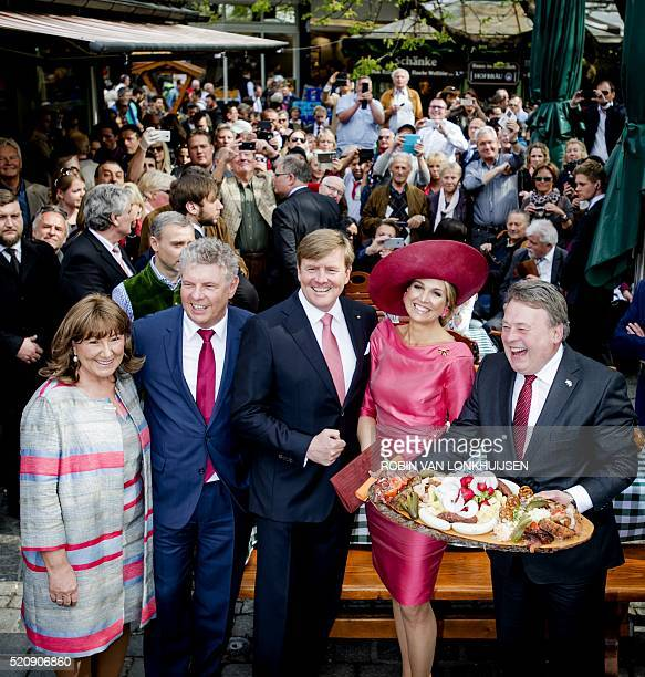 Oberburgemeister Dieter Reiter and his wife Petra pose with King WillemAlexander and Queen Maxima of the Netherlands at Viktualienmarkt in Munich on...