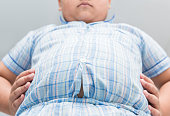 Obese fat boy overweight. Tight shirt of pajamas, healthy concept