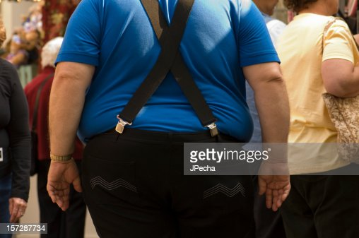 Obese Male with Blue Shirt Black Pants Suspenders Backside