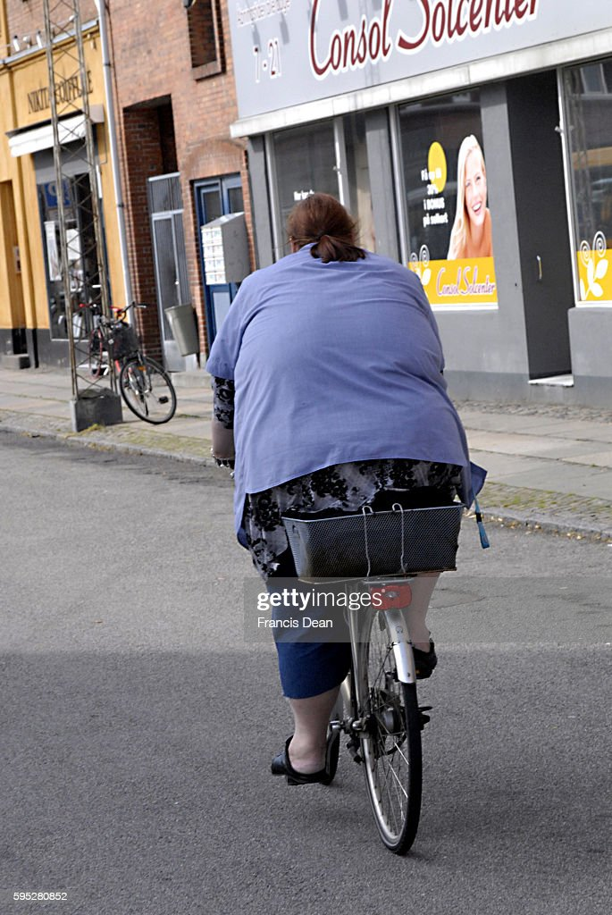 Obese or heavy or large woman biker 26 July 2011
