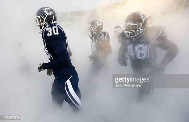 Obi Melifonwu of the Connecticut Huskies runs onto the field prior to the game against the Cincinnati Bearcats at Rentschler Field on December 1 2012...