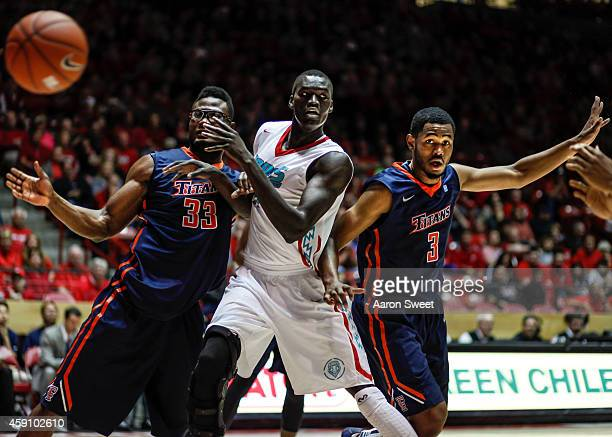 obij aget of the new mexico lobos battles for a rebound against kennedy esume and moses